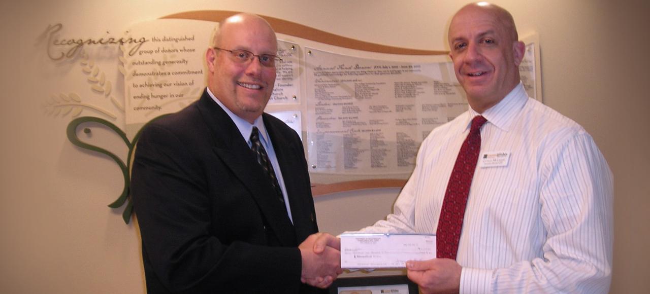 PIR handing over Charitable gift